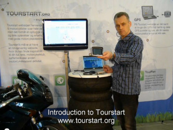 Tourstart-founder-Jan-Agnoletti-Pedersen-explaining-about-motorcycle-route-plan-next-to-Honda-vfr-750