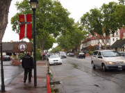 Motorcyclist walk in Solvang and Danish flag