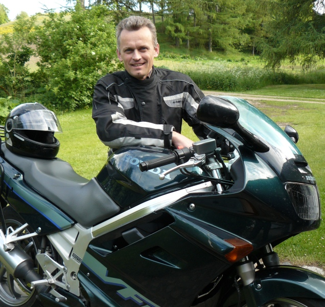 Jan Agnoletti Pedersen is founder of Tourstart, and is here seen with a Honda VFR is